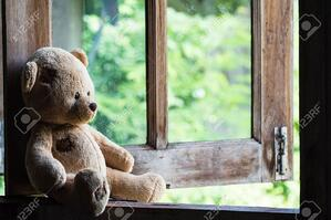 45654920-teddy-bear-sit-and-waiting-at-the-window-
