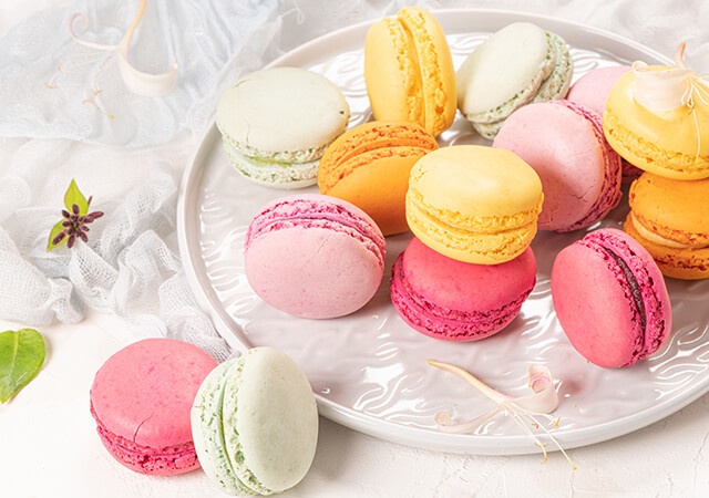 bigstock-Colorful-French-Macaroon-Cakes-392469317-640x450